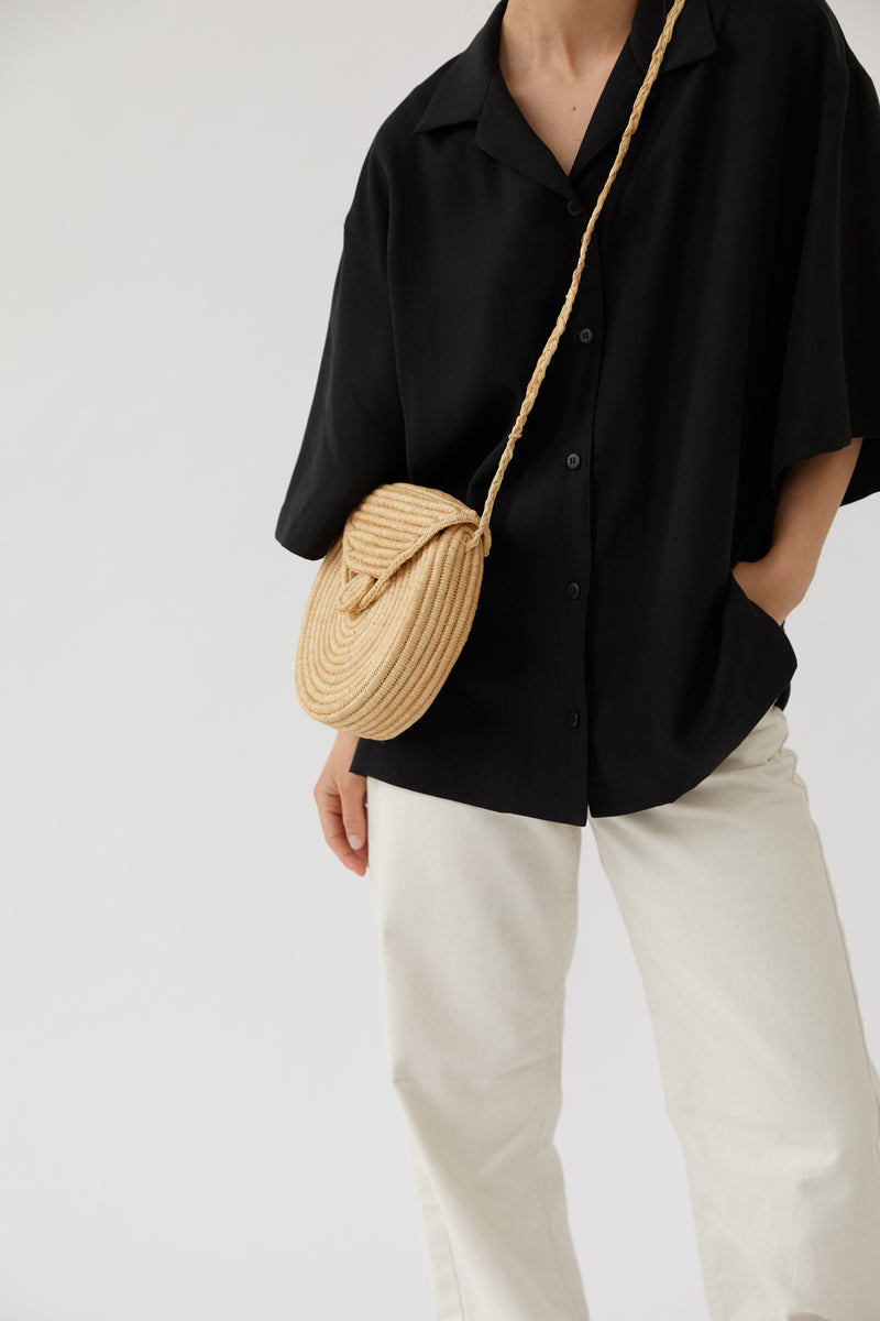 The Round Cross-Body Raffia Bag